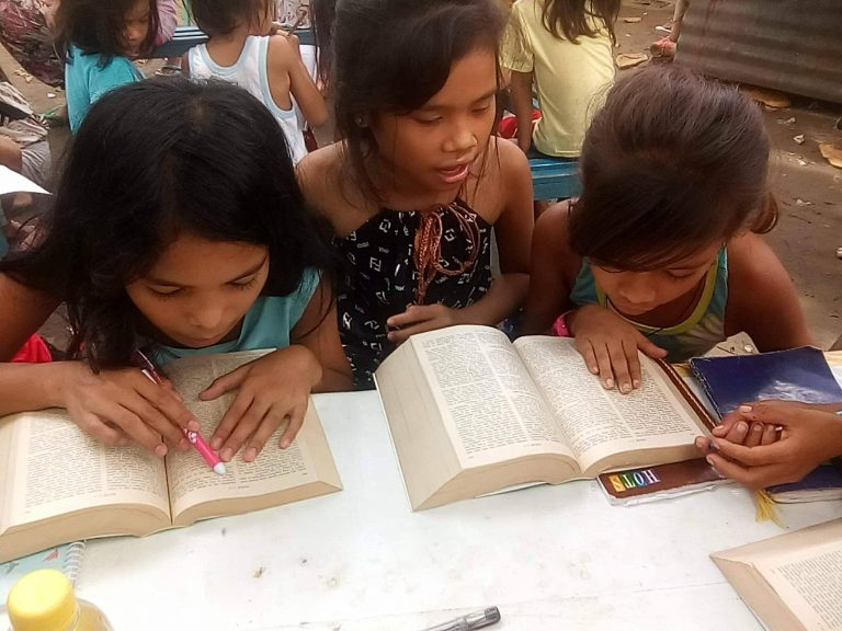 Children learning the Bible
